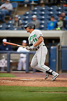 Clinton LumberKings right fielder Gareth Morgan (44) follows through on a swing during a game against the West Michigan Whitecaps on May 3, 2017 at Fifth Third Ballpark in Comstock Park, Michigan.  West Michigan defeated Clinton 3-2.  (Mike Janes/Four Seam Images)