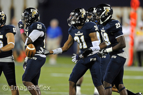 13 October 2012:  FIU cornerback Jeremiah McKinnon (31) tosses the ball to officials after a defensive stop in the fourth quarter as the Middle Tennessee State University Blue Raiders defeated the FIU Golden Panthers, 34-30, at FIU Stadium in Miami, Florida.