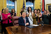 US President Donald J. Trump (C) delivers remarks during a signing ceremony for the bill, 'the Women's Suffrage Centennial Commemorative Coin Act', in the Oval Office of the White House in Washington, DC, USA, 25 November 2019. Trump signed 'H.R. 2423, the Women's Suffrage Centennial Commemorative Coin Act' - a bill directing the US Treasury to mint and issue up to four hundred thousand one-dollar silver coins honoring women that played a role in gathering support for the 19th Amendment.<br /> Credit: Michael Reynolds / Pool via CNP/AdMedia