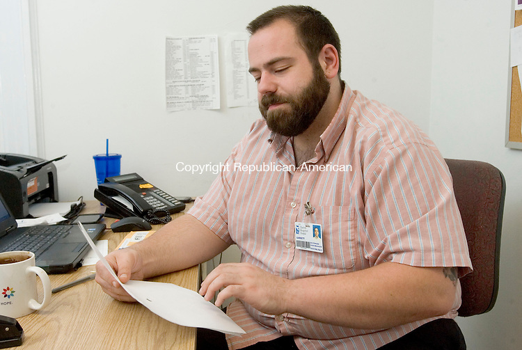 TORRINGTON CT. 12 June 2015-061215SV02-Garrett Deutermann, case manager for opiate addicts, works in his office at Charlotte Hungerford Hospital in Torrington Friday.<br /> Steven Valenti Republican-American