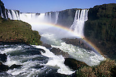 Iguassu Falls, Parana State, Brazil. Aerial view of the waterfalls with a rainbow over them.