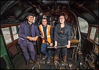 BNPS.co.uk (01202)558833<br /> Pic: PhilYeomans/BNPS<br /> <br /> Young blood - New Driver Nathan Au(27) with Fireman Josh Voce and Cleaner Beth Attfield-Haines(29).<br /> <br /> Growth Industry - Britain's enduring love affair with steam trains has led to a critical shortage of drivers, 56 years after the infamous Beeching Axe was supposed to have fallen.<br /> <br /> More steam train's are running today than at anytime since Dr Beechings drastic cut in 1963 - with over 150 steam heritage railways and museums attracting 13 million visitors a year.<br /> <br /> One of the most popular heritage railways in the country has put out an SOS for steam drivers - as so many of its stalwarts are retiring.<br /> <br /> Swanage Railway in Dorset has 42 steam drivers on their books, but the majority are in their 60s or older and likely to step down in the coming years.<br /> <br /> They need to train up to 40 drivers over the next five years to replace them and meet their expanding service, which attracts over 200,000 visitors each year.<br /> <br /> To fill the void, a group of enthuisastic young volunteers are being taught the skill, a process which can take up to a decade.<br /> <br /> The Heritage Railway Association, which oversees them, says some of their railways have a 'more pressing need for new blood'.