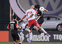 New York Red Bulls forward Tim Cahill (17) heads the ball from D.C. United defender Dejan Jakovic (5) The New York Red Bulls tied D.C. United 2-2 at RFK Stadium, Wednesday August 29, 2012.