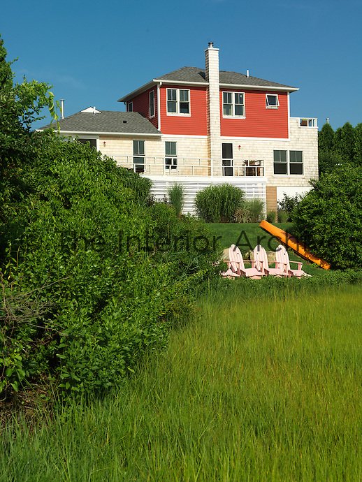 View across the garden to the clapboard and shingle exterior of this Rhode Island house