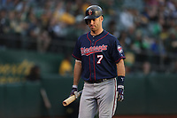 OAKLAND, CA - SEPTEMBER 22:  Joe Mauer #7 of the Minnesota Twins walks to the dugout during the game against the Oakland Athletics at the Oakland Coliseum on Saturday, September 22, 2018 in Oakland, California. (Photo by Brad Mangin)
