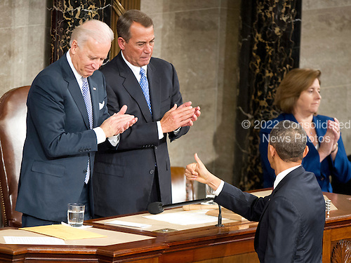 """United States President Barack Obama flashes a """"thums-up"""" after delivering his State of the Union Address to a Joint Session of Congress in the U.S. Capitol in Washington, D.C., Tuesday, January 24, 2012.  U.S. Vice President Joseph Biden and U.S. House John Boehner (Republican of Ohio) applaud..Credit: Ron Sachs / CNP.(RESTRICTION: NO New York or New Jersey Newspapers or newspapers within a 75 mile radius of New York City)"""