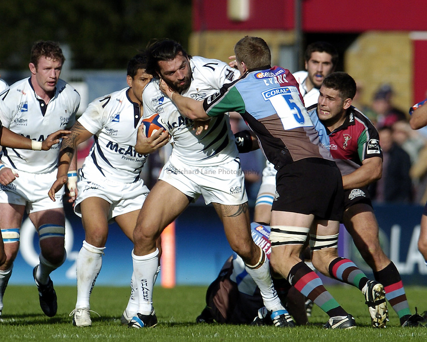 Photo: Olly Greenwood..NEC Harlequins v Sale Sharks. EDF Anglo-Welsh Cup. 07/10/2006. Sale's Sebastien Chabal is tackled by Quins Jim Evans.