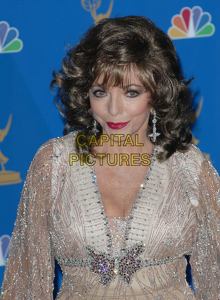 JOAN COLLINS.58th Annual Primetime Emmy Awards held at the Shrine Auditorium, Los Angeles, California, USA..August 27th, 2006.Ref: ADM/CH.half length beige jewel encrusted diamante cleavage diamonds.www.capitalpictures.com.sales@capitalpictures.com.©Charles Harris/AdMedia/Capital Pictures.