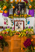 Matatlan, Oaxaca; Mexico; North America.  Escobar Family Altar in Honor of Ambrosio Escobar, Decorated for the Day of the Dead Celebrations.