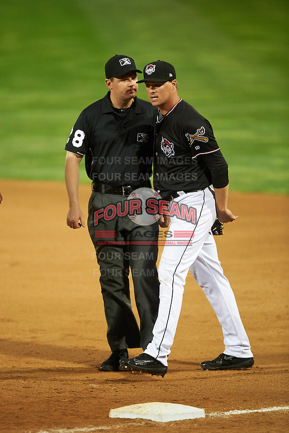 Erie SeaWolves relief pitcher Joe Mantiply (28) argues a safe call with umpire Mike Provine during a game against the Bowie Baysox on May 12, 2016 at Jerry Uht Park in Erie, Pennsylvania.  Bowie defeated Erie 6-5.  (Mike Janes/Four Seam Images)