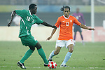 07 August 2008: Ebenezer Ajilore (NGA) (12) is defended by Urby Emanuelson (NED) (8).  The men's Olympic soccer team of the Netherlands played the men's Olympic soccer team of Nigeria at Tianjin Olympic Center Stadium in Tianjin, China in a Group B round-robin match in the Men's Olympic Football competition.
