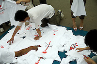 People look through Olympic- and Chinese-themed t-shirts sold by street vendors near the route of the Nanjing, China, leg of the 2008 Olympic Torch Relay.  ..