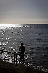 A woman walks into the sea in Alcala, Tenerife, New Years Day 2014. (c) davewalshphoto.com