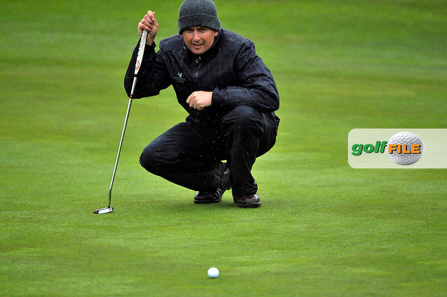 Peter Lawrie lines up his putt the 12th green during Round1 of the 3 Irish Open on 14th May 2009 (Photo by Eoin Clarke/GOLFFILE)