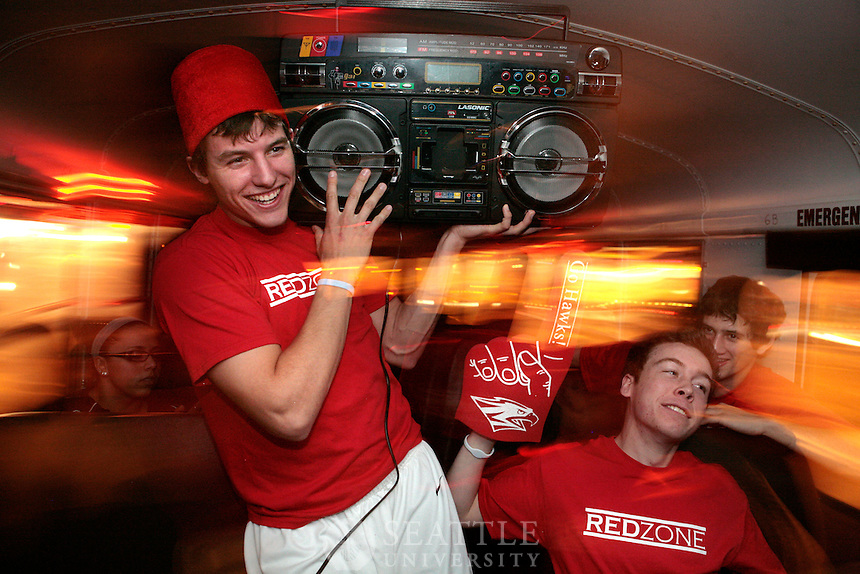 01062011 - Seattle University RedZone fans rock out on the bus enroute to the Men's Basketball game at Key Arena. The Redhawks faced up against Eastern Washington University.