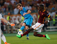 Barcellona's Ivan Rakitic is challenged by  AS Roma's Antonio Rudiger    during the Champions League Group E soccer match a   at the Olympic Stadium in Rome September 16, 2015