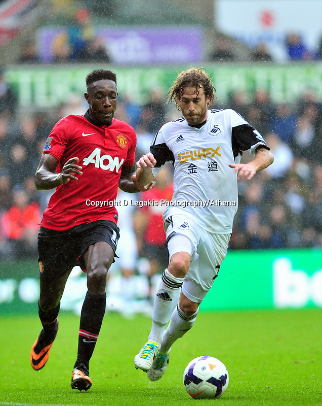 Jose Canas taking on Manchester united's Danny Welbeck.<br /> Saturday 17 August 2013<br /> Pictured: <br /> Re: Barclays Premier League Swansea City v Manchester United at the Liberty Stadium, Swansea, Wales