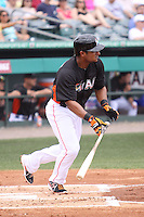 Miami Marlins second baseman Donovan Solano (17) heads towards the first base against the Houston Astros during a spring training game at the Roger Dean Complex in Jupiter, Florida on March 12, 2013. Houston defeated Miami 9-4. (Stacy Jo Grant/Four Seam Images)........