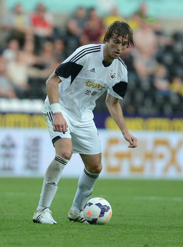 Swansea City's Michu in action during todays match  <br /> <br /> (Photo by Ian Cook/CameraSport)<br /> <br /> Football - UEFA Europa League Qualifying Play-off First leg - Swansea City v Petrolul Ploiesti - Thursday 22nd August 2013 - The Liberty Stadium - Swansea<br /> <br /> &copy; CameraSport - 43 Linden Ave. Countesthorpe. Leicester. England. LE8 5PG - Tel: +44 (0) 116 277 4147 - admin@camerasport.com - www.camerasport.com
