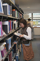Student in the library at the University of Surrey.