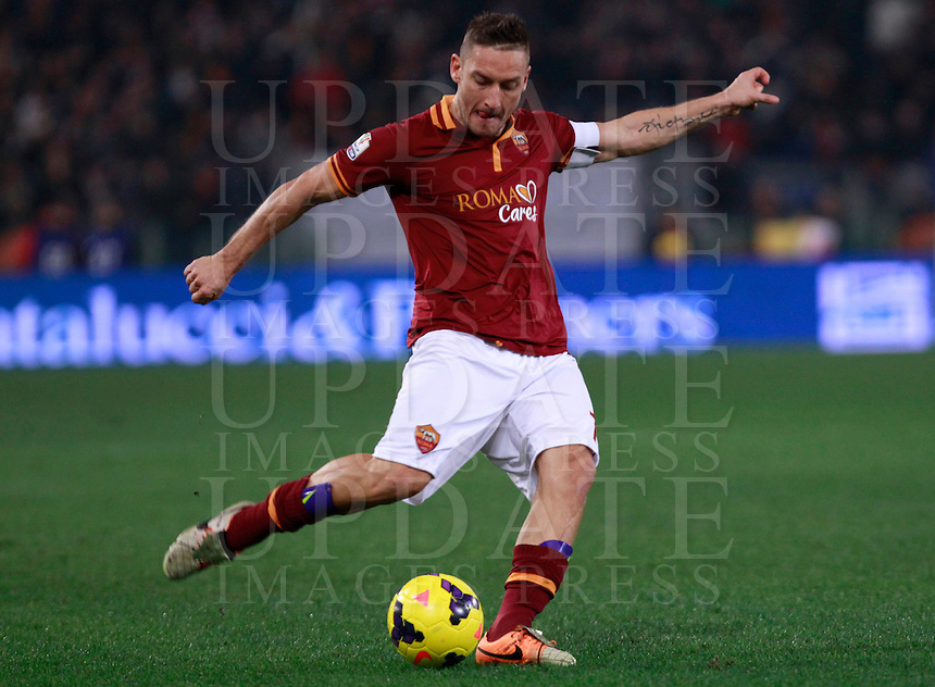 Calcio, quarti di finale di Coppa Italia: Roma vs Juventus. Roma, stadio Olimpico, 21 gennaio 2014.<br /> AS Roma forward Francesco Totti kicks the ball during the Italian Cup round of eight final football match between AS Roma and Juventus, at Rome's Olympic stadium, 21 January 2014.<br /> UPDATE IMAGES PRESS/Isabella Bonotto