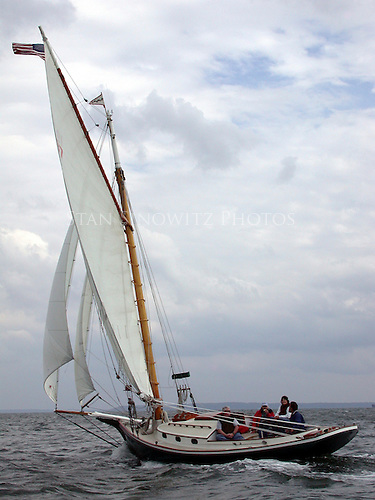 This Friendship is a fiberglass replica of the wooden sloop Defender.  She is sailing at hull speed in perfect conditions.