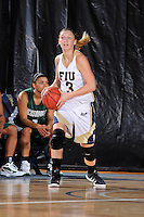 11 November 2011:  FIU's Zsofia Labady (3) handles the ball in the first half as the FIU Golden Panthers defeated the Jacksonville University Dolphins, 63-37, at the U.S. Century Bank Arena in Miami, Florida.