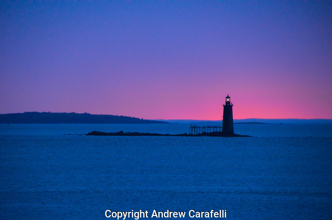 ..sailors take warning, is how the old sea ditty went. Here, a red sunrise behind Ram Island ledge Light near Portland, Maine, portends the stormy day to come.