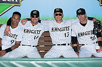 (L-R) Tyler Ladendorf (9), Ryan Raburn (16), Nicky Delmonico (13), and Danny Hayes (20) pose for a photo prior to the game against the Durham Bulls at BB&T BallPark on May 16, 2017 in Charlotte, North Carolina.  The Knights defeated the Bulls 5-3. (Brian Westerholt/Four Seam Images)