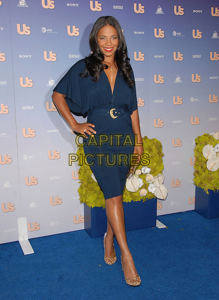 SANAA LATHAN.The US Weekly Hot Hollywood 2007 Celebration held at Opera in Hollywood, California, USA..September 26th, 2007.full length dress blue belt gold clutch purse bag shoes hand on hip .CAP/DVS.©Debbie VanStory/Capital Pictures