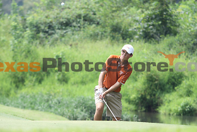 University of Texas freshman Gavin Hall chips onto the green during the Carpet Capital Collegiate at The Farm Golf Club in Rocky Face, Ga., on Sunday, Sept. 8. The Longhorns return to The Farm as defending champions after shooting a 13-under 851 in 2012.<br /> <br /> Photo by Patrick Smith