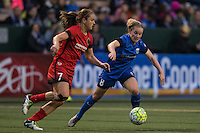 Seattle, WA - Saturday, May 14, 2016: Portland Thorns FC midfielder Lindsey Horan (7) and Seattle Reign FC midfielder Kim Little (8) chase down a ball during during the second half. The Portland Thorns FC and the Seattle Reign FC played to a 1-1 tie during a regular season National Women's Soccer League (NWSL) match at Memorial Stadium.