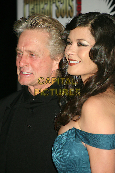 "MICHAEL DOUGLAS & CATHERINE ZETA JONES.2nd Annual ""A Fine Romance"" Benfit for the Motion Picture & Television Fund at Sunset Gower Studios, Hollywood, California, USA,.18 November 2006..portrait headshot blue dress teal off the shoulder .CAP/ADM/BP.©Byron Purvis/AdMedia/Capital Pictures."