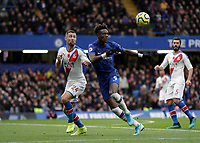 9th November 2019; Stamford Bridge, London, England; English Premier League Football, Chelsea versus Crystal Palace; Gary Cahill of Crystal Palace and Tammy Abraham of Chelsea compete for the ball - Strictly Editorial Use Only. No use with unauthorized audio, video, data, fixture lists, club/league logos or 'live' services. Online in-match use limited to 120 images, no video emulation. No use in betting, games or single club/league/player publications