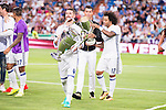 Real Madrid's player Sergio Ramos, Cristiano Ronaldo and Marcelo with the Europe Supercup and Champions League Cup during the XXXVII Santiago Bernabeu Trophy in Madrid. August 16, Spain. 2016. (ALTERPHOTOS/BorjaB.Hojas)