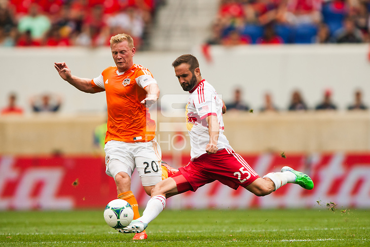 Brandon Barklage (25) of the New York Red Bulls is marked by Andrew Driver (20) of the Houston Dynamo. The New York Red Bulls defeated the Houston Dynamo 2-0 during a Major League Soccer (MLS) match at Red Bull Arena in Harrison, NJ, on June 30, 2013.