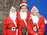 Betty Tiernan, Bernadette Malone and Joan Watchorn who took part in the Santa Dash. Photo: Colin Bell/pressphotos.ie