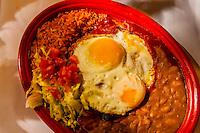 Blue Corn Enchiladas with red chile with egg, El Pinto Restaurant and Cantina, Albuquerque, New Mexico USA