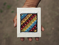 A small textile weaving made by weaver Román Gutiérrez Ruiz (cq) at his home and weaving studio in Teotitlán del Valle, Oaxaca, in Mexico, Tuesday, April 10, 2012. Gutiérrez Ruiz is known for his fine rugs and tapestries throughout Mexico as only using natural dyes and creating fine weavings with as many as 30 threads per inch. This rug, about 4 inches square, sells for 2,500 pesos or $180...Photo by Matt Nager