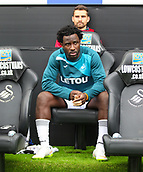 10th September 2017, Liberty Stadium, Swansea, Wales; EPL Premier League football, Swansea versus Newcastle United; New signing and returning Wilfried Bony of Swansea City sits on the bench before kick off