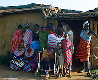 A group portrait with Anna and her baby and various Masai
