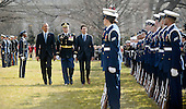 United States President Barack Obama, left, reviews the troops with Prime Minister Justin Trudeau of Canada, right, during an Arrival Ceremony on the South Lawn of the White House in Washington, DC on Thursday, March 10, 2016. <br /> Credit: Olivier Douliery / Pool via CNP