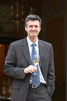Jean-Marc Lallier-Deutz of the Deutz family, director of the company tasting holding a glass of champagne outside the tasting room at Champagne Deutz in Ay, Vallee de la Marne, Champagne, Marne, Ardennes, France
