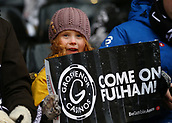 17th March 2018, Craven Cottage, London, England; EFL Championship football, Fulham versus Queens Park Rangers; Young Fulham fan holding up Come on Fulham banner inside Craven Cottage before kick off