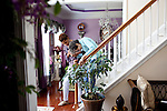 "Karen Morris has been caring for her mother Gloria, 80, for the past 10 years. Her mother has Alzheimer's disease and lives with Karen and Karen's husband Richard in their Charlotte, NC home. She helps her mother walk down the stairs...Mrs. Morris was a nurse before she retired and really enjoys taking care of people, she said. Every morning she washes her mother in the bathroom, helps her walk down the stairs, and they share breakfast, as they did Monday, October 18, 2010...Gloria was having an especially bad day and because Karen sees her every day, she knew something was wrong. She later discovered her medication was dehydrating her. That is one of many reasons why having a regular caretaker is so important. ..Released: Yes.""Caretaker"".Assignment c/o Ilene Bellovin"