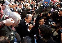 Il senatore e presidente dell'Italia dei Valori Antonio Di Pietro, al centro, affiancato dal deputato Leoluca Orlando, a destra, parla ai giornalisti mentre siede in terra tra i lavoratori di ex Eutelia ed Agile, aziende appartenenti al gruppo Omega, durante una protesta davanti a Palazzo Chigi, Roma, 17 novembre 2009..Italian senator and former magistrate Antonio Di Pietro, president of L'Italia dei Valori party, center, flanked by deputy Leoluca Orlando, right, talks to reporters as he sits on the ground among Eutelia and Agile (Omega group) workers during a protest in front of Chigi Palace, Rome, 17 november 2009..UPDATE IMAGES PRESS/Riccardo De Luca