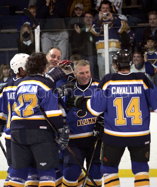 (Sunday, December 03, 2006)-Former members of the St. Louis Blues congratulate Brett Hull, center, on scoring the game-tying goal during the St. Louis Blues Alumni Hockey Game at the Summit Center in Chesterfield. Brett Hull's number, 16, was retired.