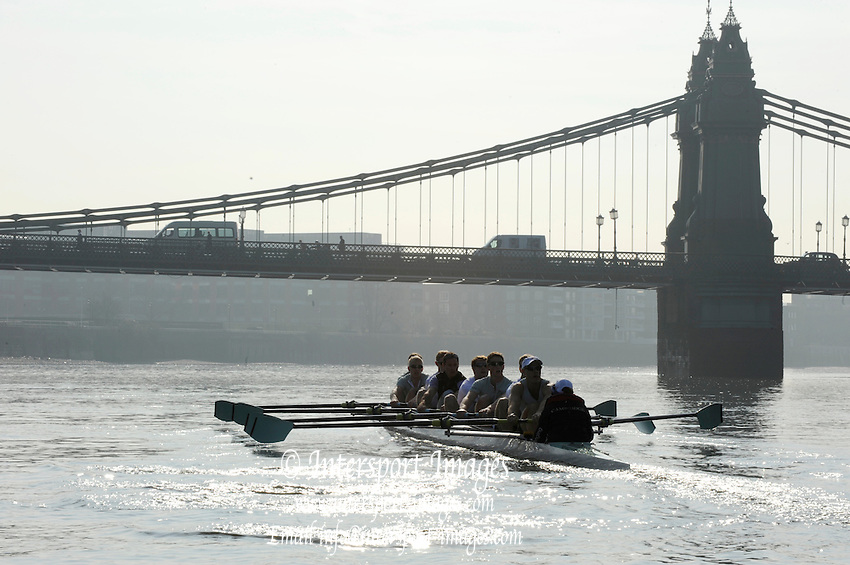 Putney. London. CUBC Blue Boat early morning training on Hammersmith Bend, approaching Hammersmith Bridge, Tideway Week, build up to the  2011 University Boat Race over parts of the Championship Course - Putney to Mortlake. Thursday  24/03/2011[Mandatory Credit; Peter Spurrier/Intersport-images]..Cambridge (from bow): Mike THORP (GB), Joel JENNINGS (GB), Dan RIX-STANDING (GB), Hardy CUBAUSH (Aus), George NASH (GB), Geoff ROTH (Can), Derek RASMUSSEN (US), David NELSON (Aus), Cox: Liz BOX (GB) 2011 Tideway Week