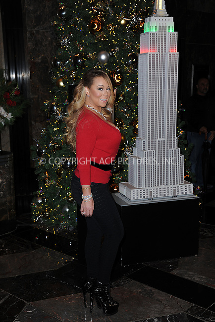 www.acepixs.com<br /> December 6, 2016  New York City<br /> <br /> Mariah Carey at The Empire State Building lighting ceremony for the holiday season on December 6, 2016 in New York City.<br /> <br /> <br /> Credit: Kristin Callahan/ACE Pictures<br /> <br /> <br /> Tel: 646 769 0430<br /> Email: info@acepixs.com
