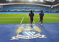 Ki Sung-Yueng and Bafetibis Gomis of Swansea City ahead of the Barclays Premier League match between Manchester City and Swansea City played at the Etihad Stadium, Manchester on December 12th 2015